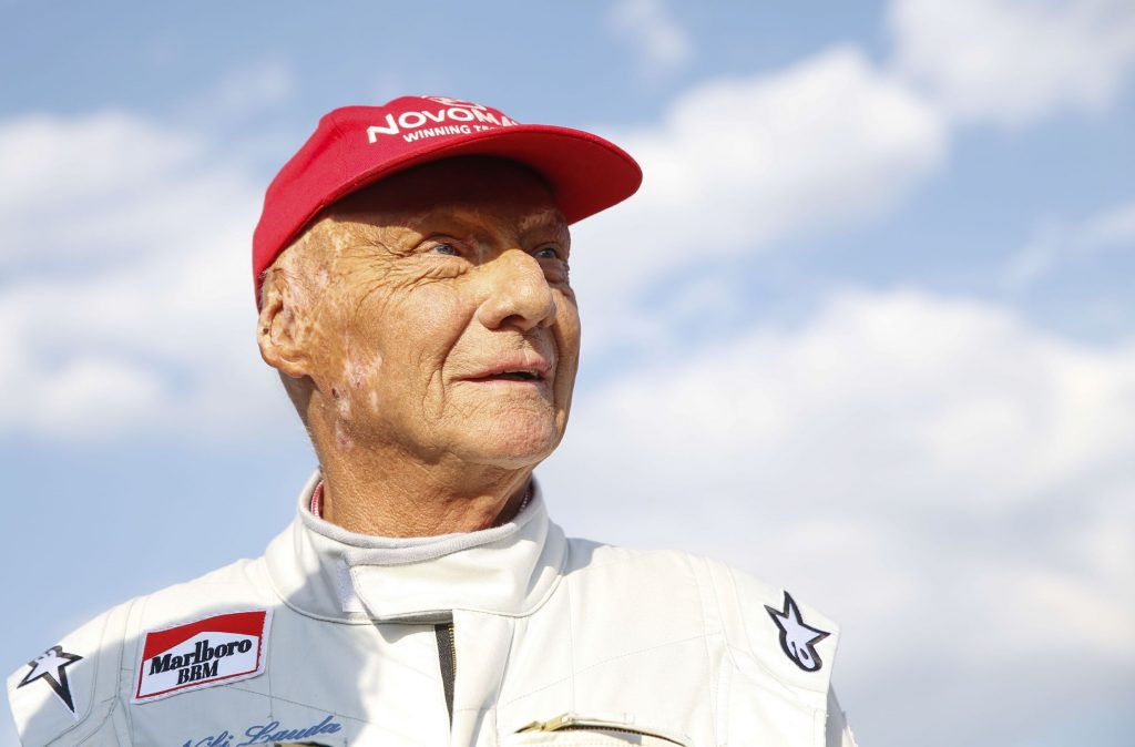 Niki Lauda at the 2018 Legends Race in Spielberg, Austria in a white racing suit and his trademark red hat