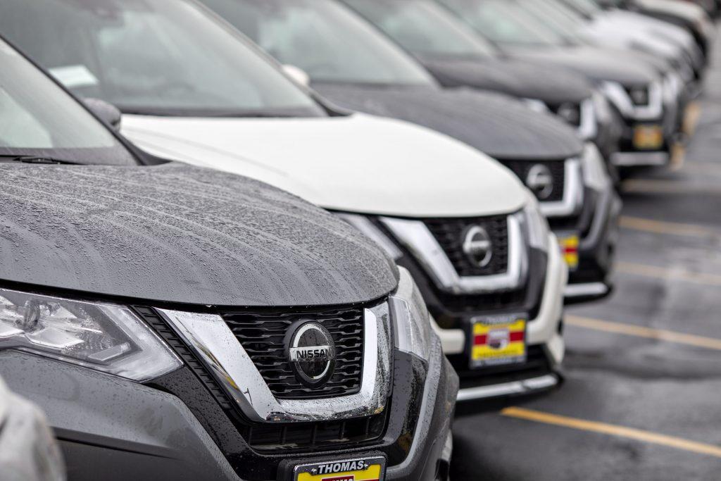 Nissan Rogue SUVs on display at a dealership