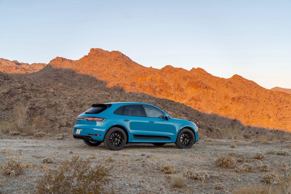 Miami Blue 2021 Porsche Macan GTS ripping through a canyon