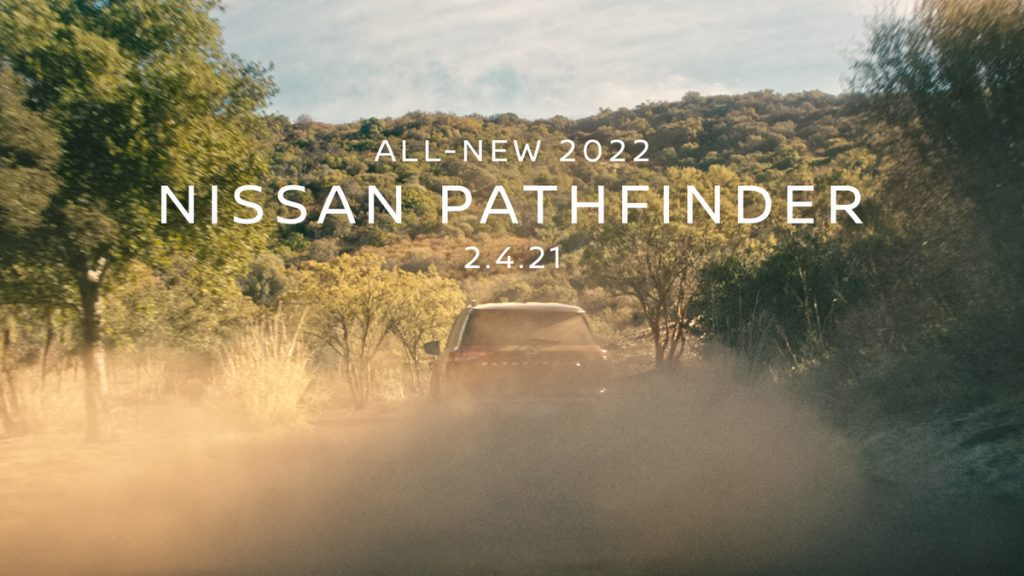 The new 2022 Nissan Pathfinder hidden by a cloud of dust