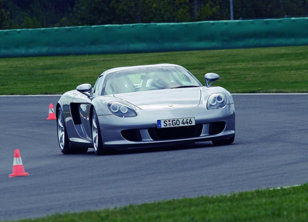 An image of a Porsche Carrera GT rolling down the road.