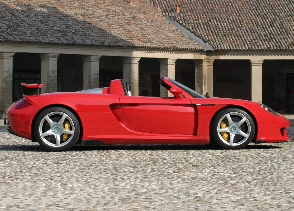 An image of a Porsche Carrera GT parked outside.