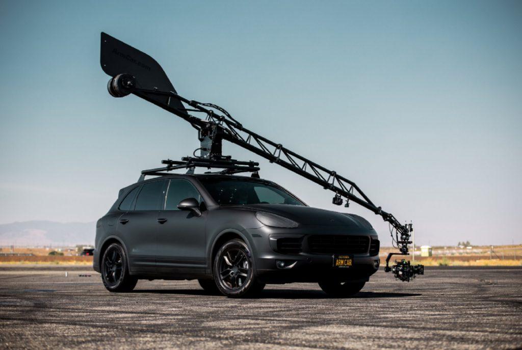 The matte-black Porsche Cayenne 'Arm Car' on a desert racetrack