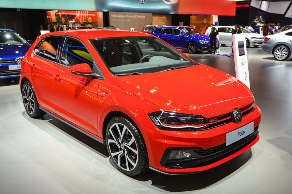 A red Volkswagen GTI on display at an auto show