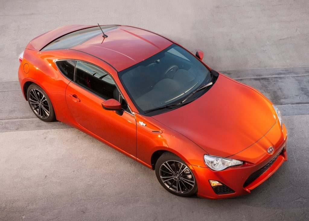 a top view of an orange 2013 Scion FR-S