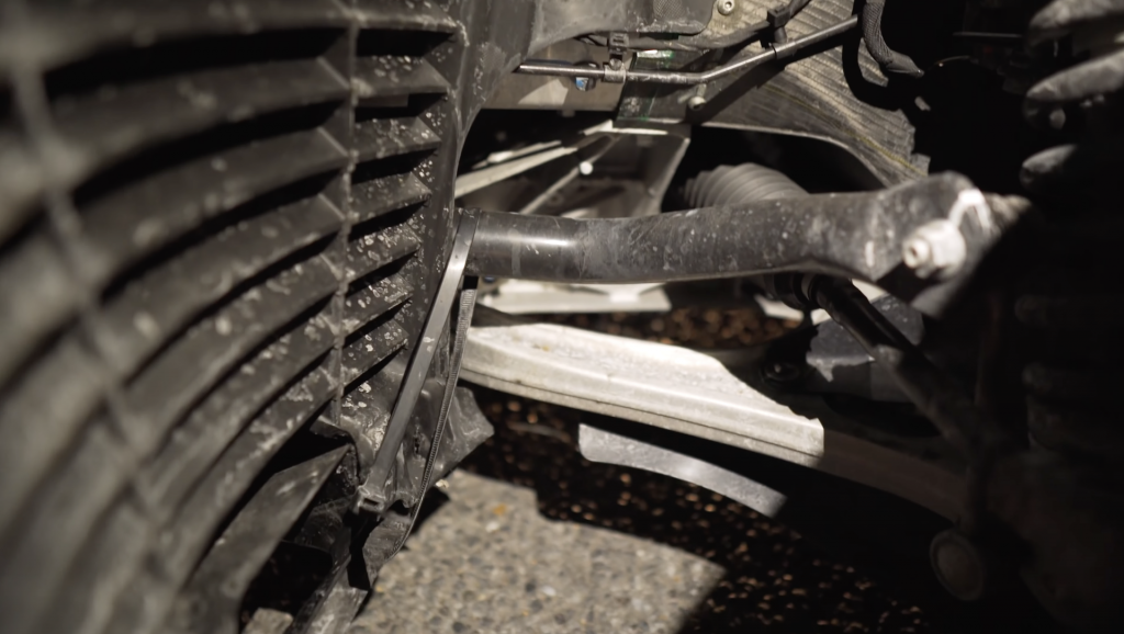 An image of a McLaren 600LT showing damage held together by zip ties.