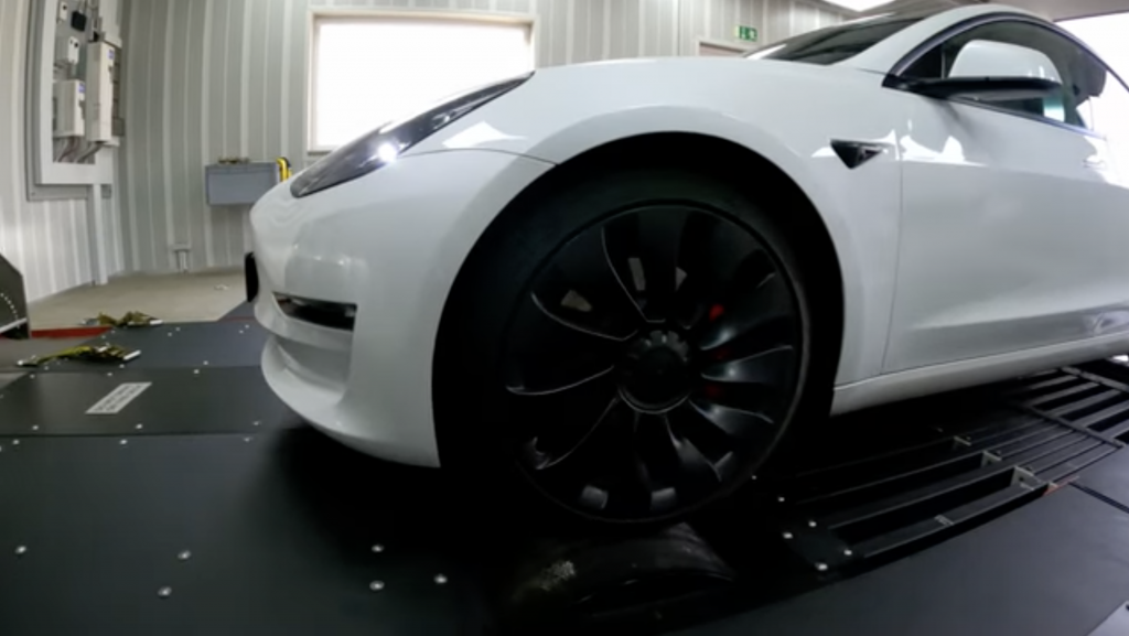 An image of a white Tesla Model 3 Performance on the dyno.
