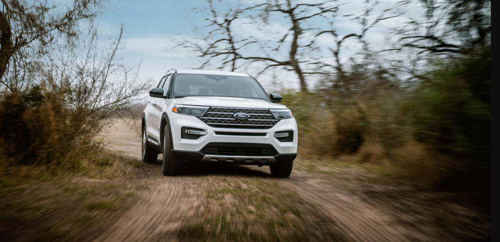 The 2021 Ford Explorer King Ranch edition driving on a dirt road