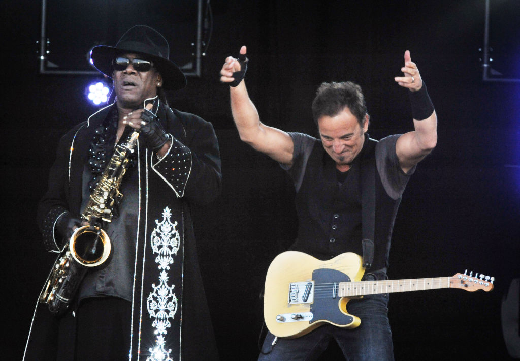 Musician Bruce Springsteen giving two thumbs up on stage