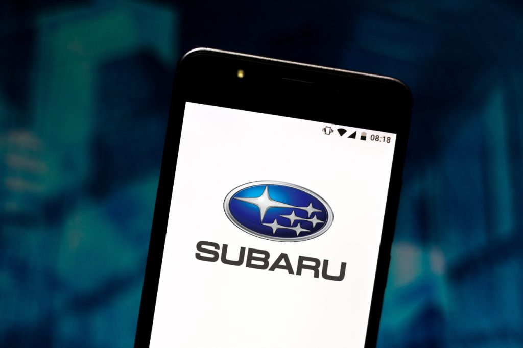A Subaru logo displayed on a cell phone screen