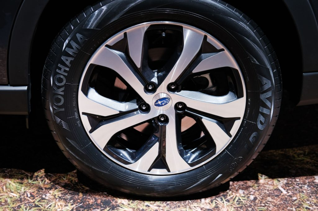The tire on a Subaru Outback displayed at an auto show