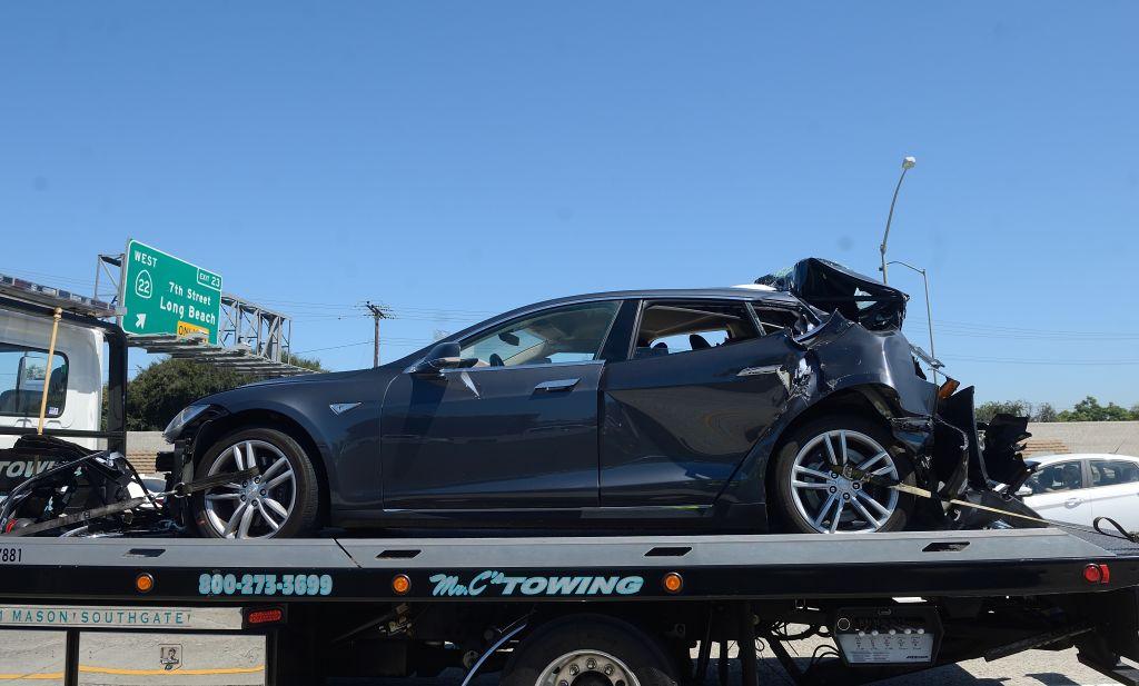 Blue Tesla on trailer after crash