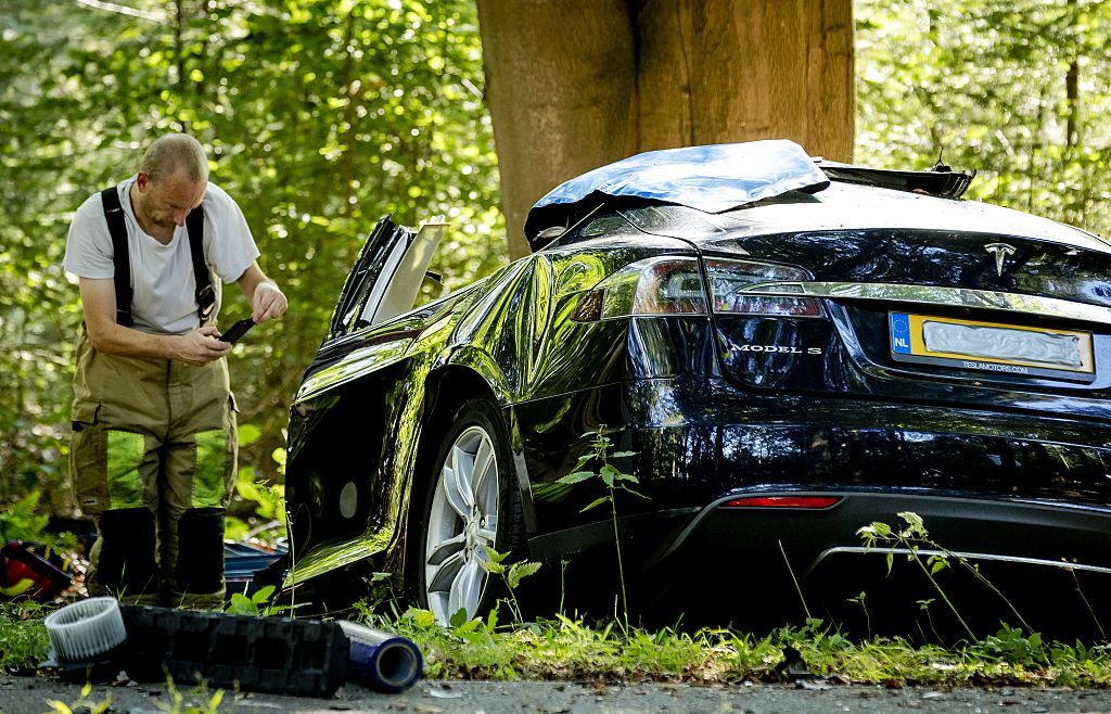 Investigator at site of Tesla crash