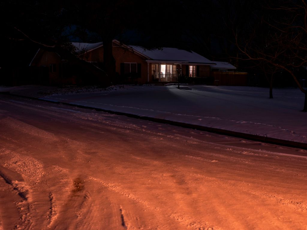 lone house with lights on in Texas power outage