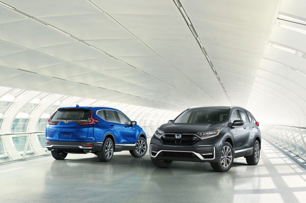 A blue 2020-2021 Honda CR-V and a grey 2020-2021 Honda CR-V Hybrid on display next to each other