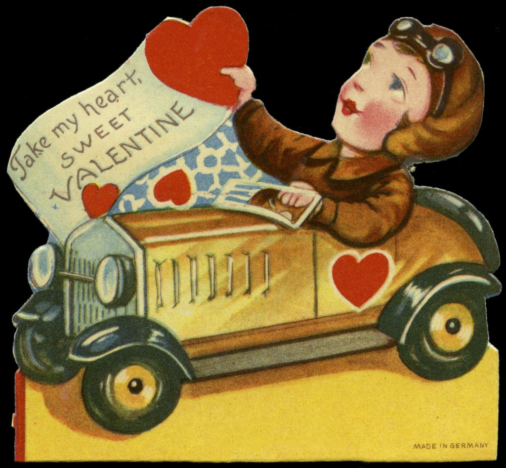 """An old Valentine's Day card picturing a cartoon boy driving a car while holding a heart with a banner that reads """"Take My Heart, Sweet Valentine."""""""