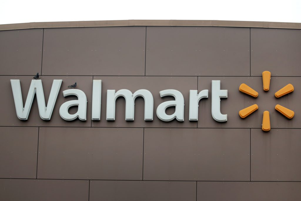 A sign hangs outside of a Walmart store in Chicago, Illinois.