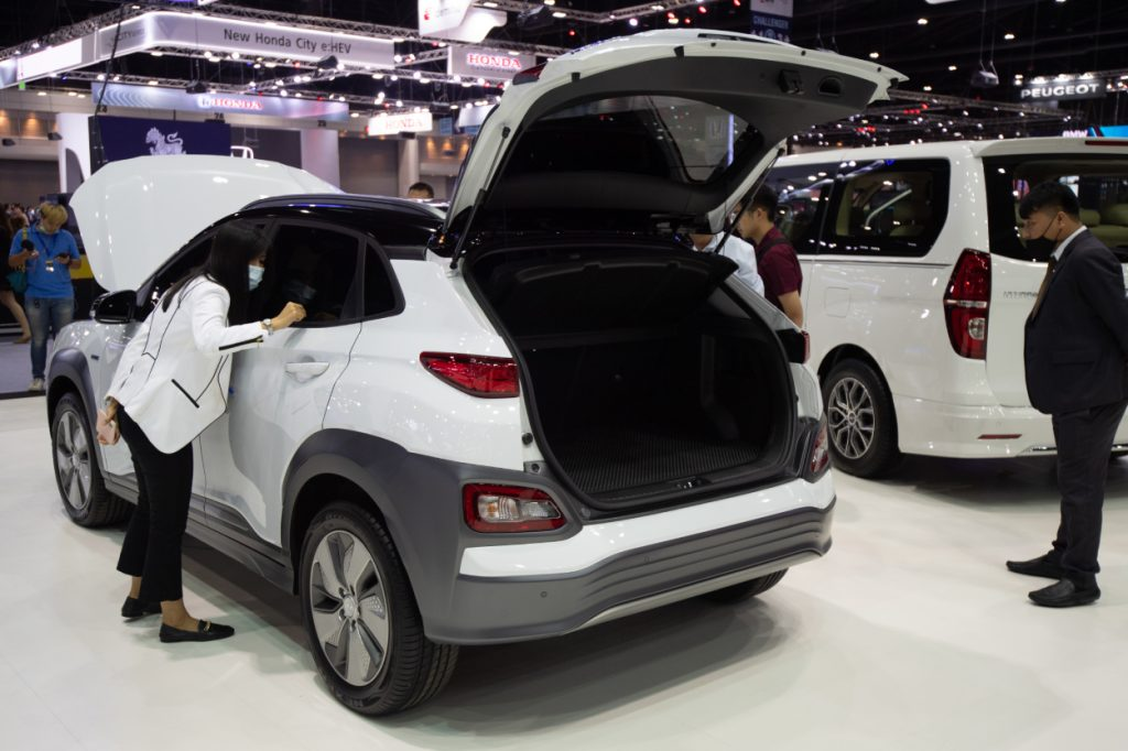 A white Hyundai Kona on display at an auto show