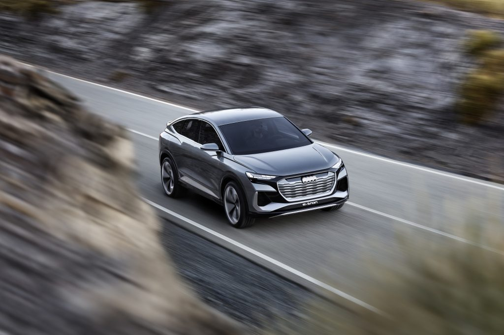 an Audi e-tron at speed on a mountain road
