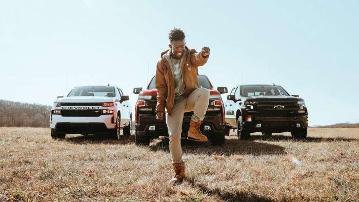 Artist named BRELAND dancing in front of three 2021 Chevy Silverado models