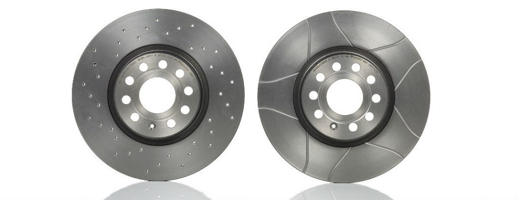 A visual comparison between drilled rotors and slotted rotors | Brembo