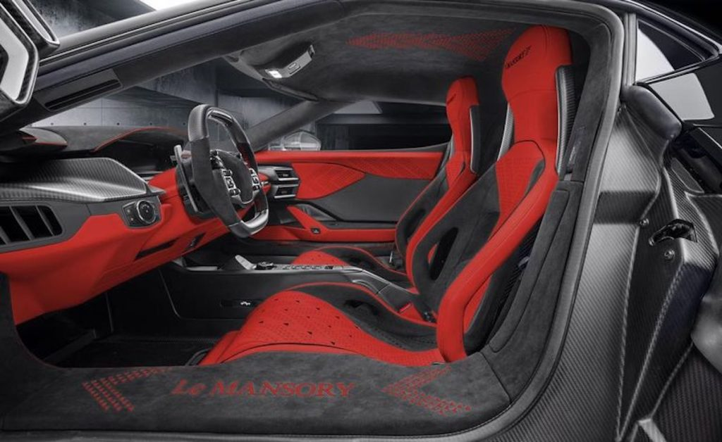 The Le Mansory #2 interior is in grey, black, and red in a garage