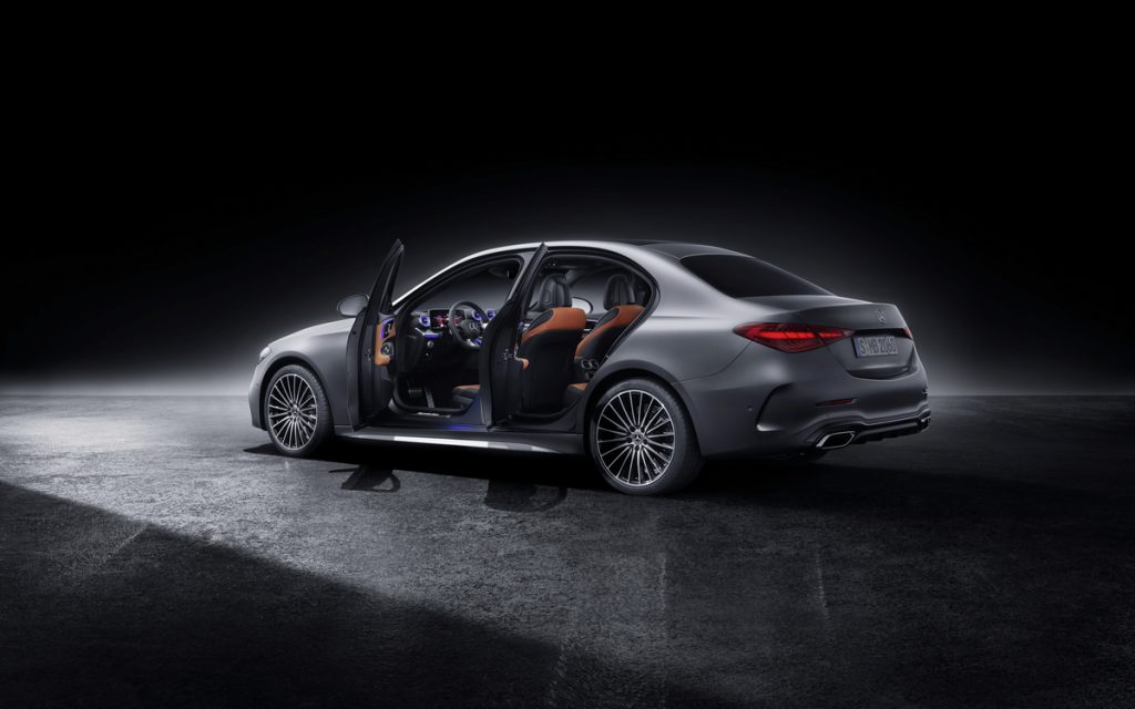 A side preview of the 2022 Mercedes-Benz C-Class with the doors open to show the interior
