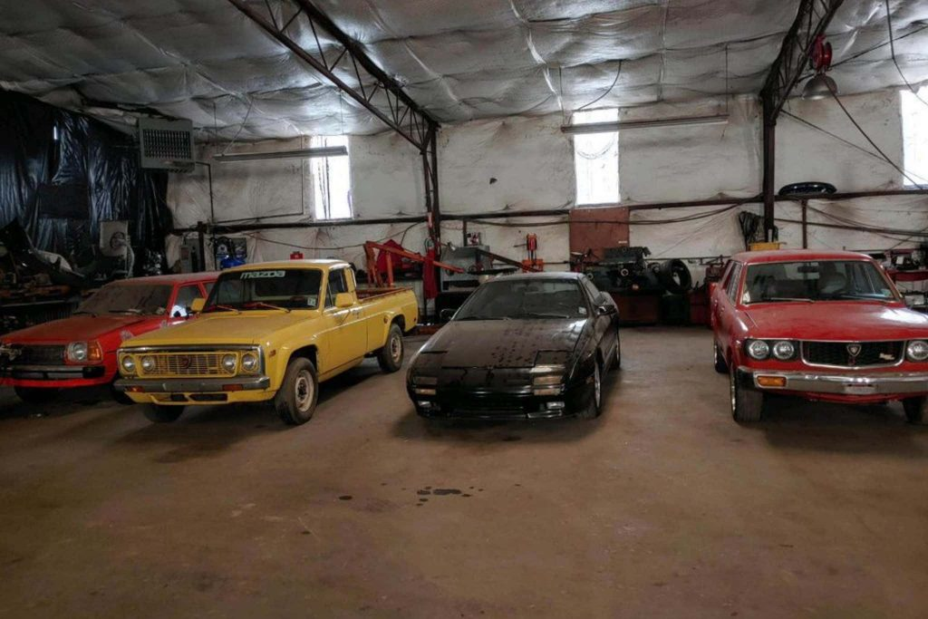 a few selections fomr the massive barn of rotary cars; a yellow mazda pickup and two other dusty finds.