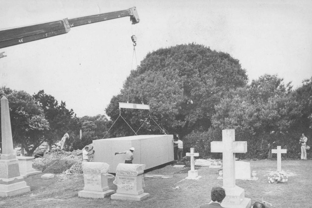An image of a grave dug out to feature a Ferrari 330 America and its owner.