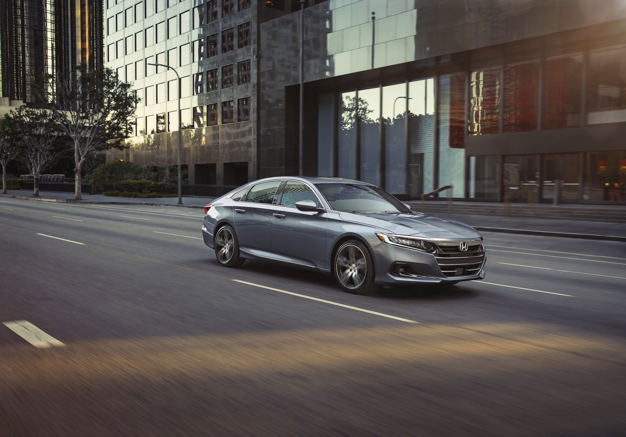 a silver 2021 Honda Accord driving in the city at speed