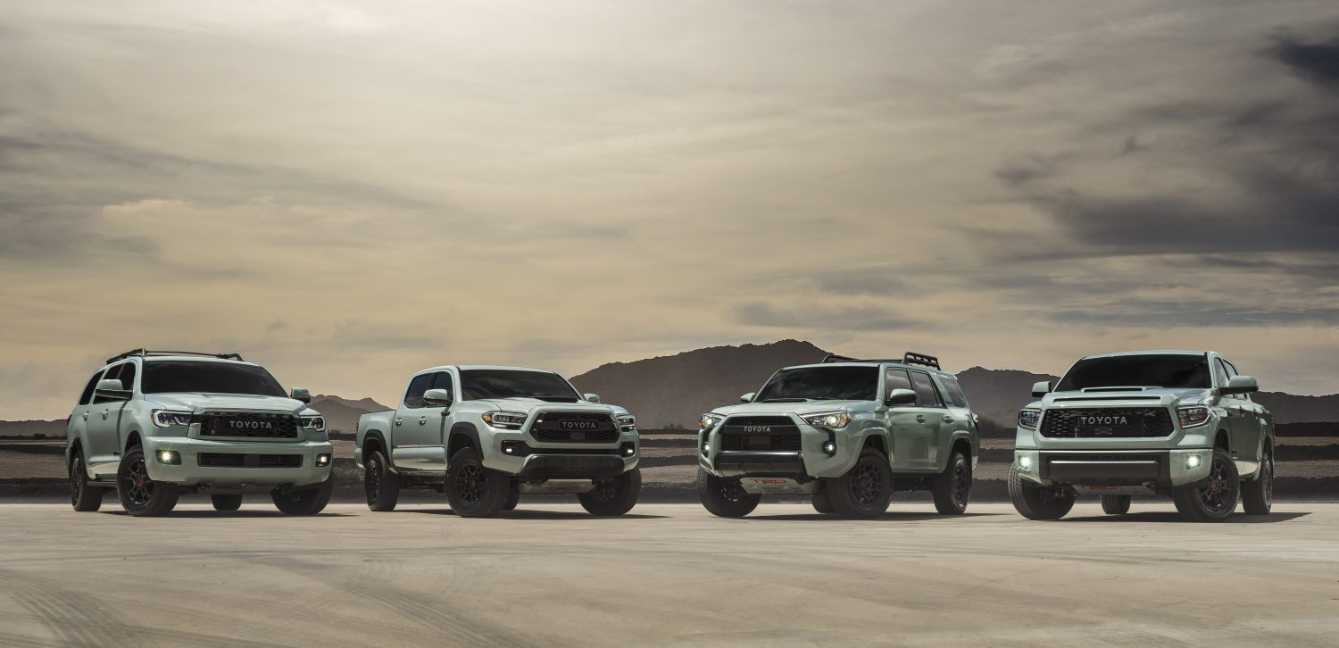 Toyota TRD Pro 2021 lineup in the desert with mountains behind in the distance.