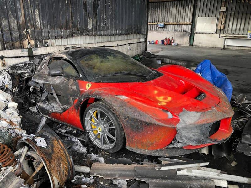 An image of a destroyed car collection featuring a Ferrari LaFerrari.