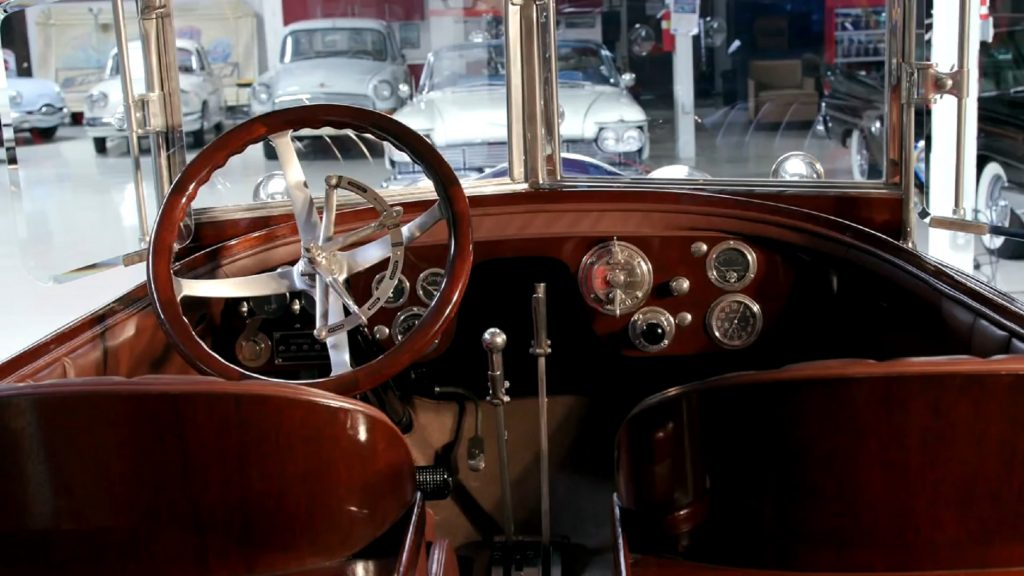 The brown-leather front seats and mahogany-and-teak dashboard of Jay Leno's 1916 Crane-Simplex Holbrook Skiff