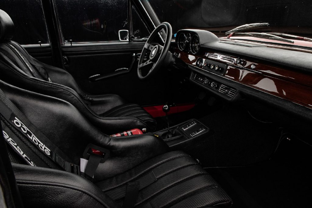 The black-leather front bucket seats and real-wood-trim of a 1971 Mercedes 300 SEL 6.8 AMG 'Red Pig' replica