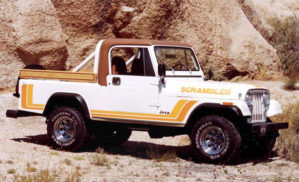 1982 Jeep CJ-8 Scrambler parked near mountains
