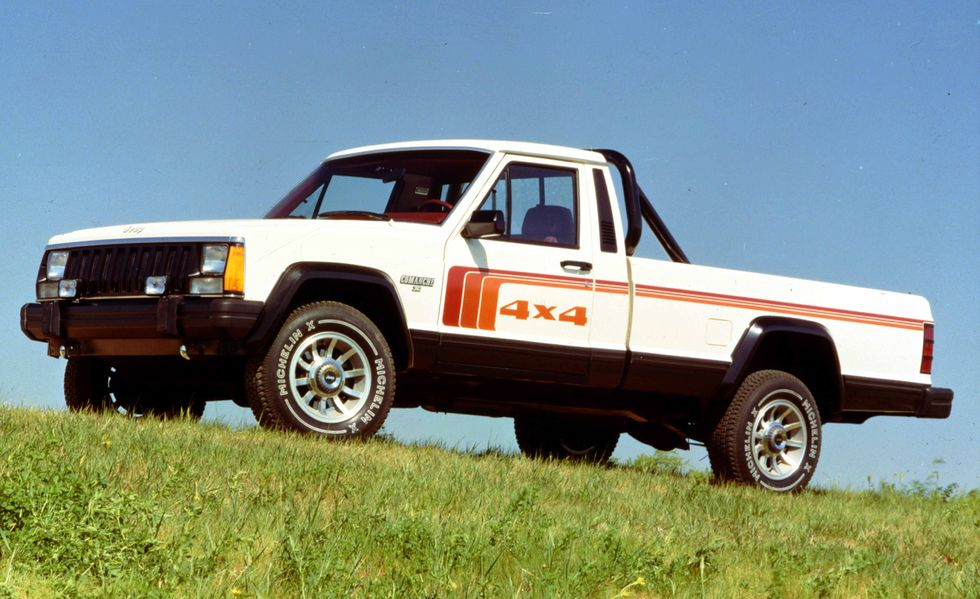 The 1986 Jeep Comanche parked in grass