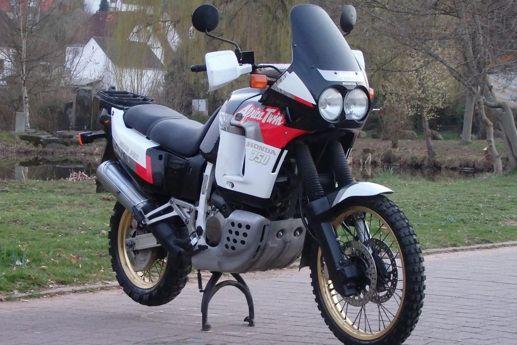 A white-red-and-black 1991 Honda Africa Twin XRV750 RD04 on a driveway