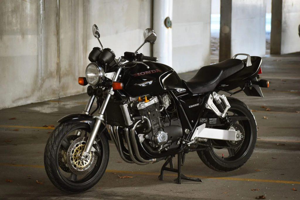 A black 1994 Honda CB1000 Super Four in a parking garage