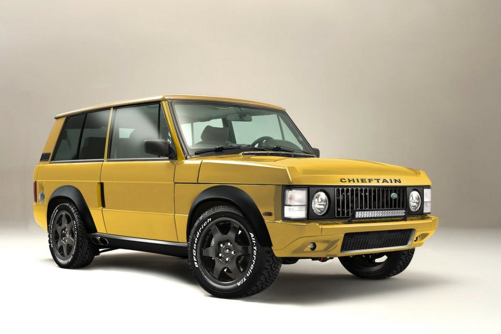 An image of a yellow Range Rover Chieftain by Jensen International Automotive inside of a studio.