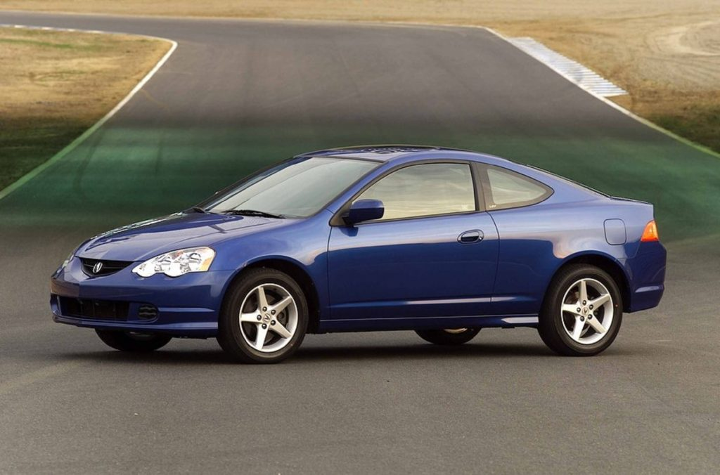 A blue 2002 Acura RSX Type S parked on a racetrack