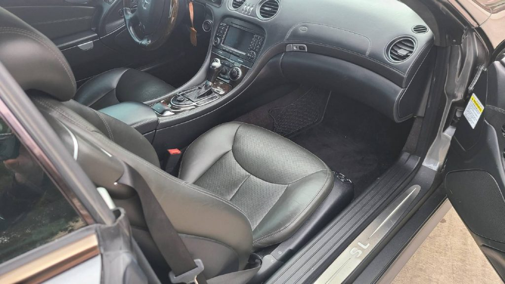 The black-leather-upholstered interior of a 2005 Mercedes-Benz SL600