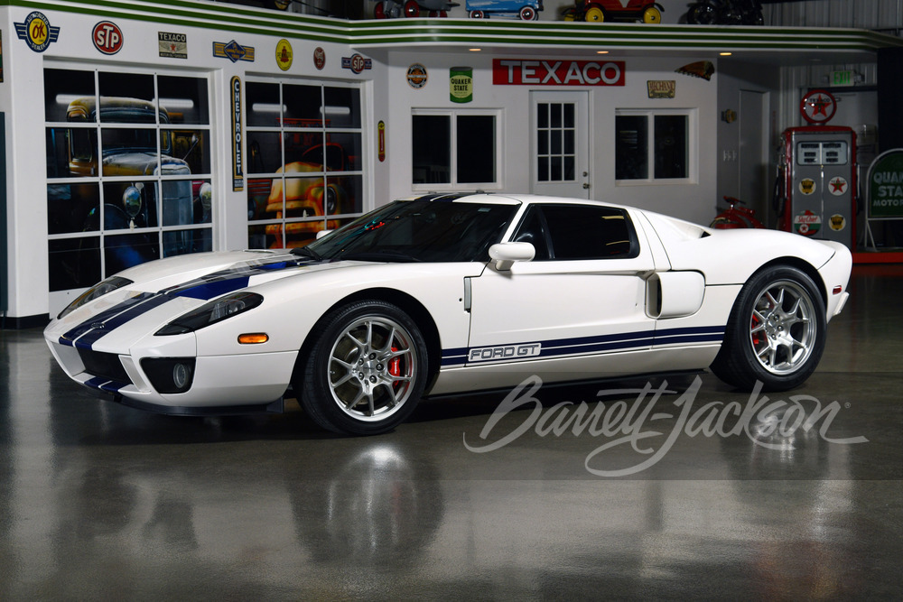A white 2006 Ford GT with blue racing stripes