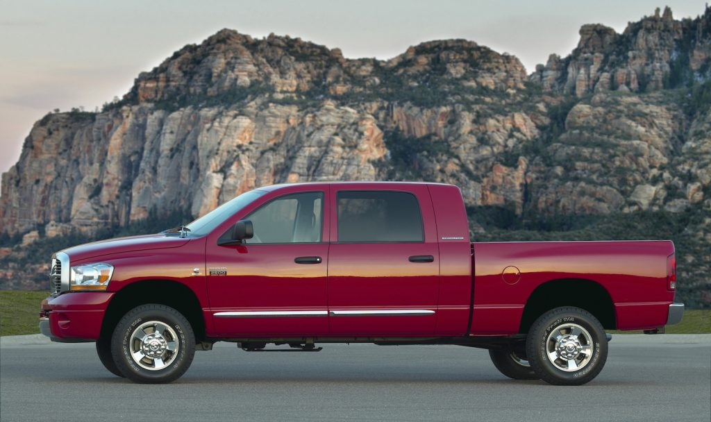 A red 2008 Dodge Ram diesel pickup with a manual transmission