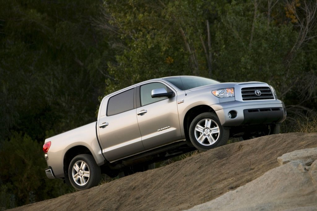 2008 Toyota Tundra driving up a grassy hill
