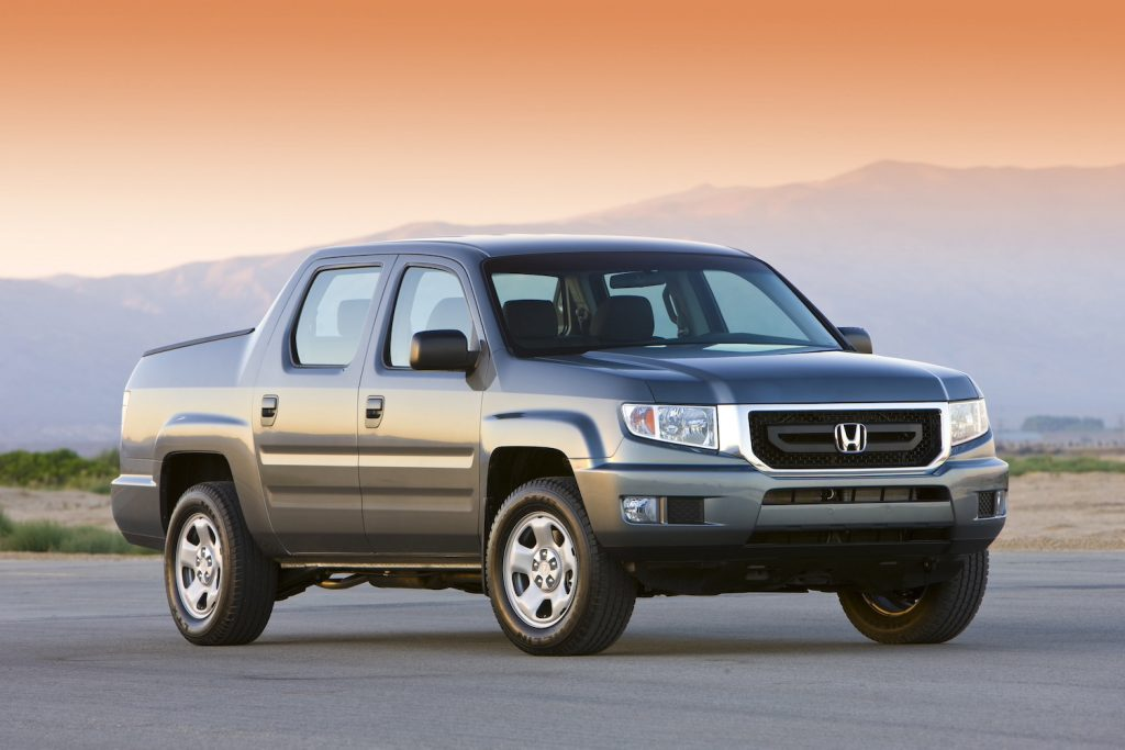 2009 Honda Ridgeline RT parked at sunset