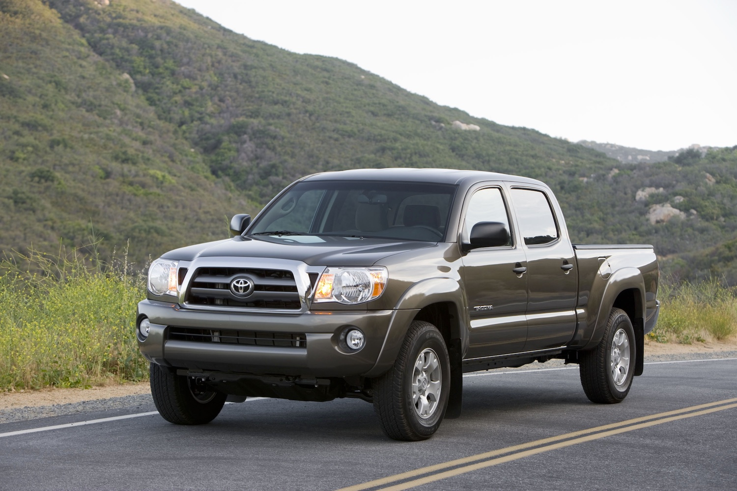 a 2009 model from the second Toyota Tacoma generation driving on a mountain road.
