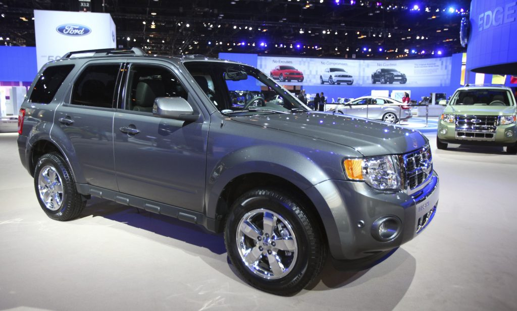 A 2011 Ford Escape compact SUV on display at an auto show