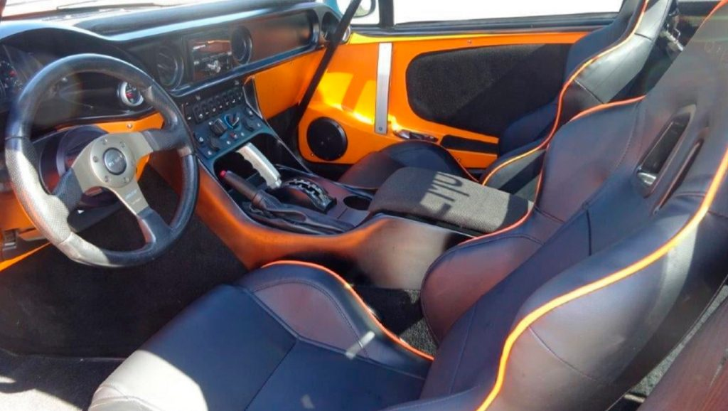 The front interior of a 2012 Local Motors Rally Fighter with optional leather seats and audio system