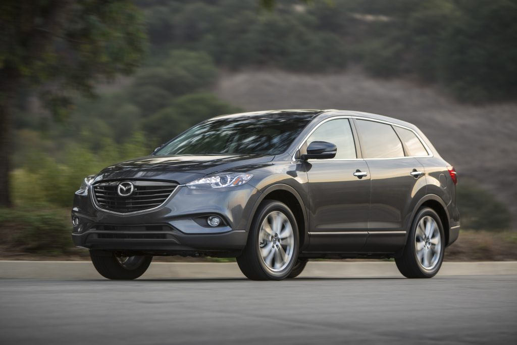 A grey 2013 Mazda CX-9 driving down the road