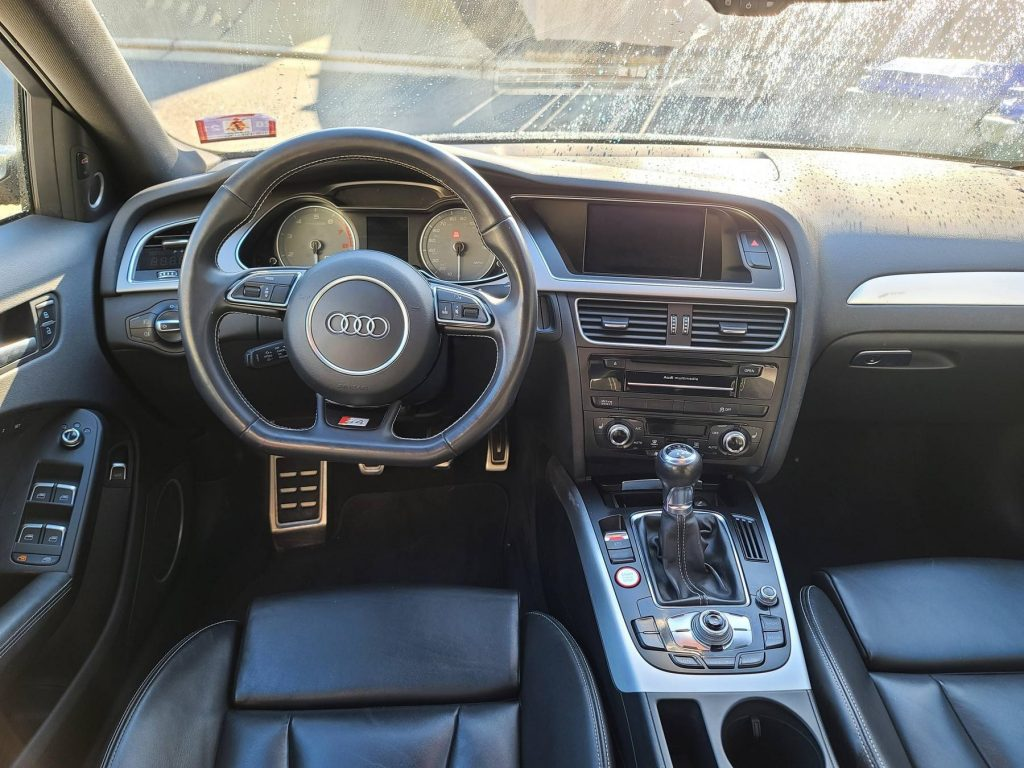 The black-leather front seats and dashboard of a 2014 Audi S4